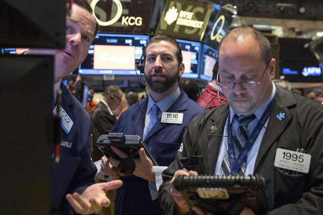 Traders work on the floor of the New York Stock Exchange March 14, 2014. REUTERS/Brendan McDermid