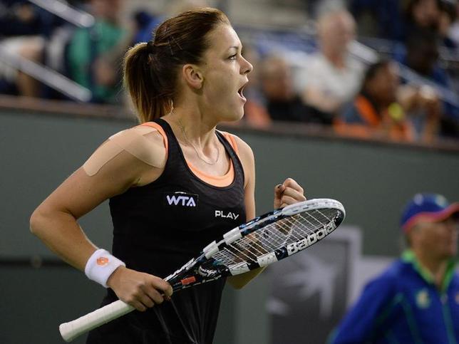 Mar 12, 2014; Indian Wells, CA, USA; Agnieszka Radwanska (POL) reacts during her match against Jelena Jankovic (not pictured) at the BNP Paribas Open at the Indian Wells Tennis Garden. Radwanska won 7-5, 2-6, 6-4. Jayne Kamin-Oncea-USA TODAY Sports