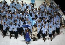 The team from Fiji arrives at the Melbourne Cricket Ground stadium during the Commonwealth Games opening ceremony in Melbourne March 15, 2006. REUTERS/Tim Wimborne
