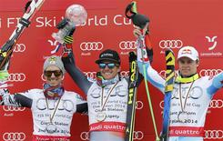 Men's giant slalom winner Ted Ligety of the U.S. is flanked by Austria's runner up Marcel Hirscher (L) and third placed Alexis Pinturault of France during a ceremony at the FIS Alpine Skiing World Cup Finals in Lenzerheide March 15, 2014. REUTERS/Leonhard Foeger