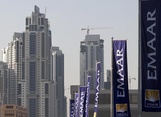 Flags for property company EMAAR, builders of Burj Dubai the world's tallest tower, are seen in Dubai, November 27, 2009. REUTERS/Steve Crisp