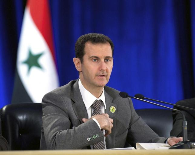 Syria's President Bashar al-Assad speaks during his meeting with the leadership al-Baath party of Damascus countryside,in Damascus March 8, 2014,in this handout released by Syria's national news agency SANA. REUTERS/SANA/Handout via Reuters