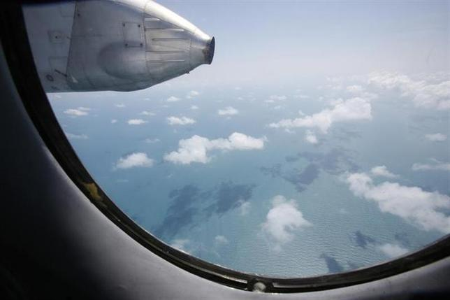Clouds hover outside the window of a Vietnam Air Force search and rescue aircraft An-26 on a mission to find the missing Malaysia Airlines flight MH370, off Vietnam's Tho Chu island March 10, 2014. REUTERS/Kham