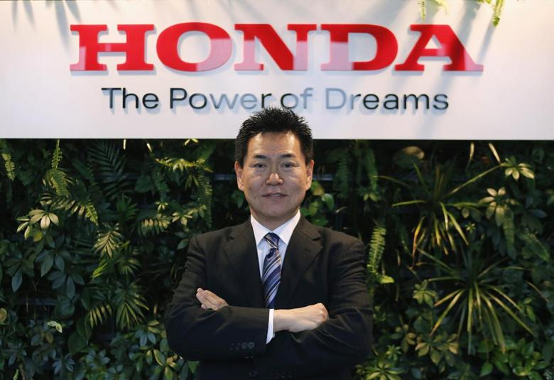 Yasuhisa Arai, Senior Managing Officer and Director, Chief Officer of Motorsports, Honda R&D Co. poses at the Honda Motor Co's headquarters in Tokyo February 27, 2014. REUTERS/Yuya Shino