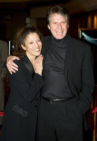 Comedian David Brenner and his girlfriend, champion figure skater Tai Babilonia, pose at an after party at the premiere of U.S singer-songwriter Barry Manilow's show 'Manilow: Music and Passion' at the Las Vegas Hilton Theatre in Las Vegas, Nevada in this February 24, 2005, file photo. REUTERS/Ethan Miller/Files