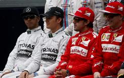 (L-R) Mercedes Formula One driver Lewis Hamilton of Britain, Mercedes Formula One driver Nico Rosberg of Germany, Ferrari Formula One driver Fernando Alonso of Spain and Ferrari Formula One driver Kimi Raikkonen of Finland pose during a photo call ahead of the Australian F1 Grand Prix at the Albert Park circuit in Melbourne March 16, 2014. REUTERS/David Gray