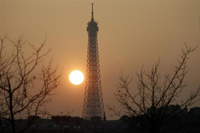 The Eiffel tower is pictured during sunset as warm and sunny weather continues in France, March 14, 2014. REUTERS/Charles Platiau