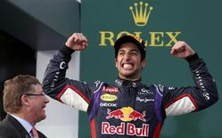 Red Bull Formula One driver Daniel Ricciardo of Australia (R) celebrates finishing second in the Australian F1 Grand Prix at the Albert Park circuit in Melbourne March 16, 2014. REUTERS/David Gray