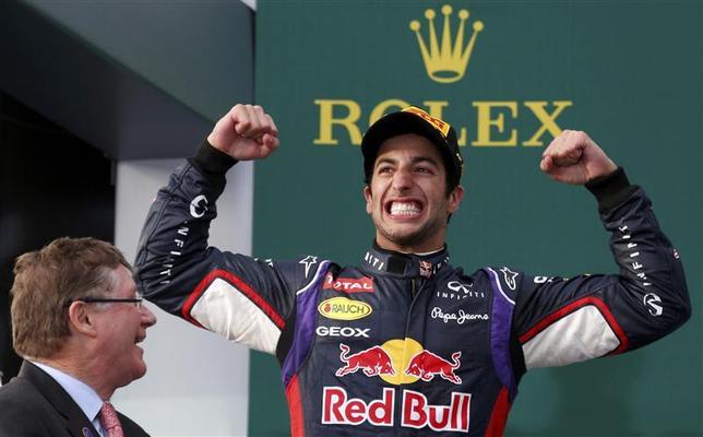 Red Bull Formula One driver Daniel Ricciardo of Australia (R) celebrates finishing second in the Australian F1 Grand Prix at the Albert Park circuit in Melbourne March 16, 2014. REUTERS/David Gray