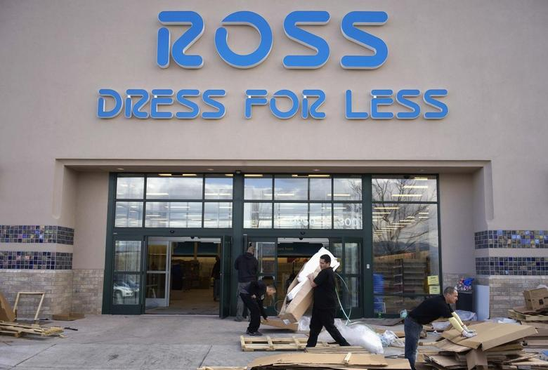 Workers prepare a new Ross store which is opening soon in Broomfield, Colorado in this file photo taken February 27, 2014. REUTERS/Rick Wilking/Files