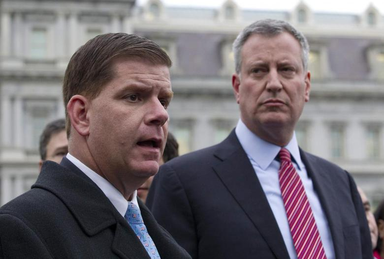 Bill de Blasio and Martin Walsh (L) speak to the press outside the West Wing of the White House in Washington, December 13, 2013, following their meeting with U.S. President Barack Obama and other newly-elected mayors about job creation. REUTERS/Jason Reed