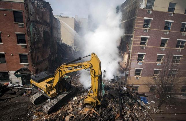 New York City emergency responders search through the rubble at the site of a building explosion in the Harlem section of New York, March 13, 2014. REUTERS/Brendan McDermid