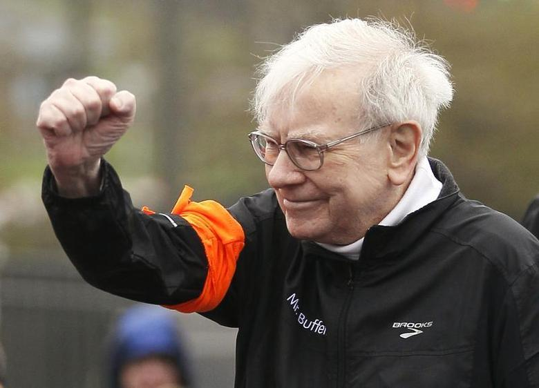 Berkshire Hathaway chairman Warren Buffett gestures at the start of a 5km race sponsored by Brooks Sports Inc., a Berkshire-owned company, in Omaha May 5, 2013, a day after the company's annual meeting. REUTERS/Rick Wilking