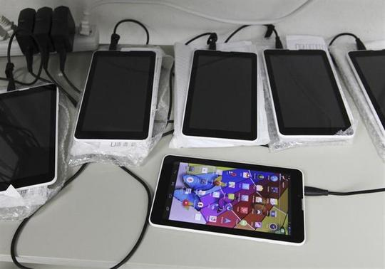 New Android-based tablets assembled from imported components are charged at the Surtab factory in the Sonapi Industrial Park of Port-au-Prince March 11, 2014. REUTERS/Marie Arago