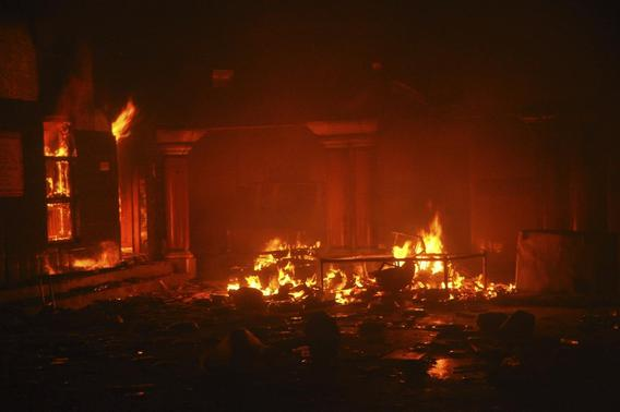 A Hindu temple burns after it was attacked in Larkana, southern Pakistan's Sindh province, March 15, 2014. REUTERS-Faheem Soormro