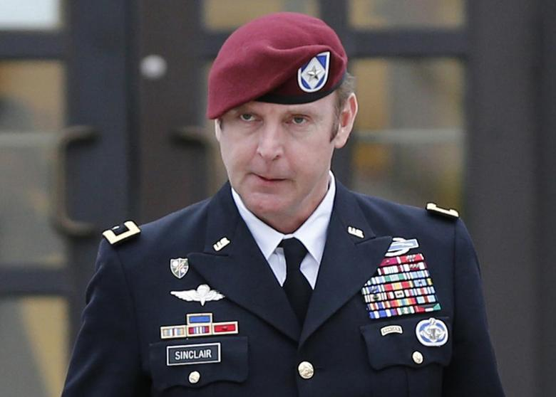 Army Brigadier General Jeffrey Sinclair (C) leaves the courthouse with attorneys Richard Scheff (L) and Ellen Brotman at Fort Bragg in Fayetteville, North Carolina March 4, 2014. REUTERS/Ellen Ozier