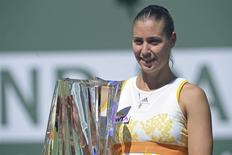 Mar 16, 2014; Indian Wells, CA, USA; Flavia Pennetta (ITA) with the championship trophy after winning final match against Agnieszka Radwanska (POL) at the BNP Paribas Open at the Indian Wells Tennis Garden. Pennetta won6-2, 6-1. Mandatory Credit: Jayne Kamin-Oncea-USA TODAY Sports