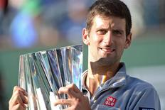 Mar 16, 2014; Indian Wells, CA, USA; Novak Djokovic (SRB) with the championship trophy after winning the BNP Paribas Open against Roger Federer (SUI) at the Indian Wells Tennis Garden. Djokovic won 6-3, 3-6, 7-6. Mandatory Credit: Jayne Kamin-Oncea-USA TODAY Sports