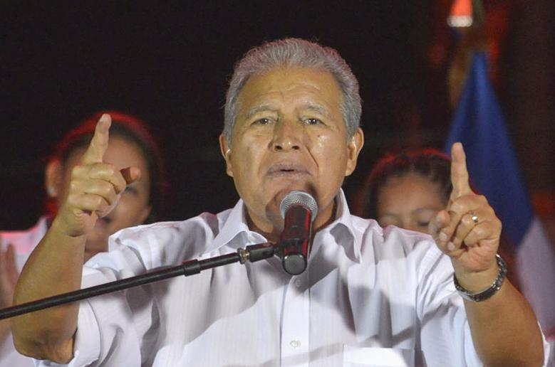 Salvador Sanchez Ceren, the presidential candidate for the Farabundo Marti National Liberation Front (FMLN), gives a speech to thousands of supporters gathered to celebrate their victory in the presidential election in San Salvador March 15, 2014. REUTERS/Jessica Orellana
