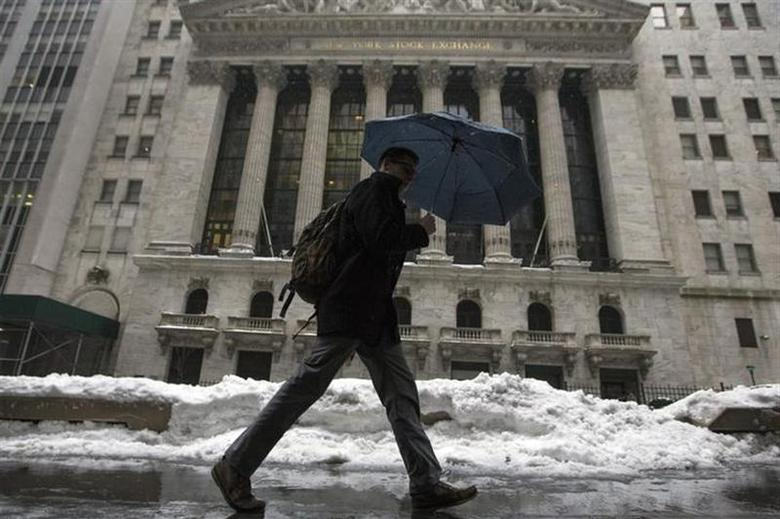 A man walks past the New York Stock Exchange in New York's financial district February 13, 2014. REUTERS/Brendan McDermid/Files