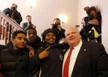Toronto Mayor Rob Ford poses for a photo with high school students during a break at a meeting of Canadian mayors in Ottawa February 26, 2014. REUTERS/Chris Wattie