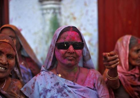 Widows celebrate Holi