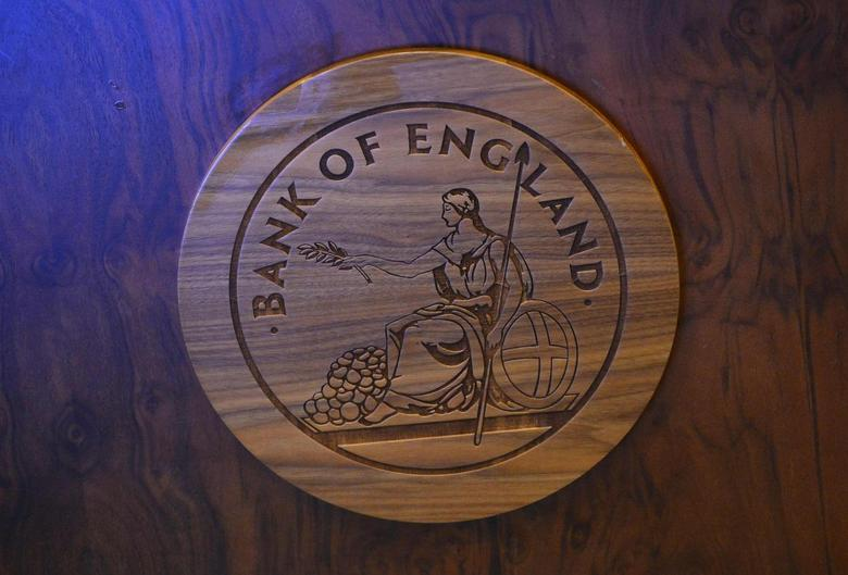 A wooden carving of the Bank of England logo is seen on a desk during the bank's quarterly inflation report news conference at the Bank of England in London November 13, 2013. REUTERS/Toby Melville