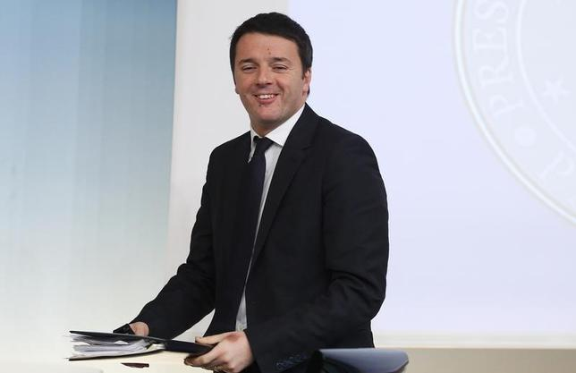 Italy's Prime Minister Matteo Renzi smiles as he arrives to lead a news conference at Chigi palace in Rome March 12, 2014. REUTERS/Remo Casilli