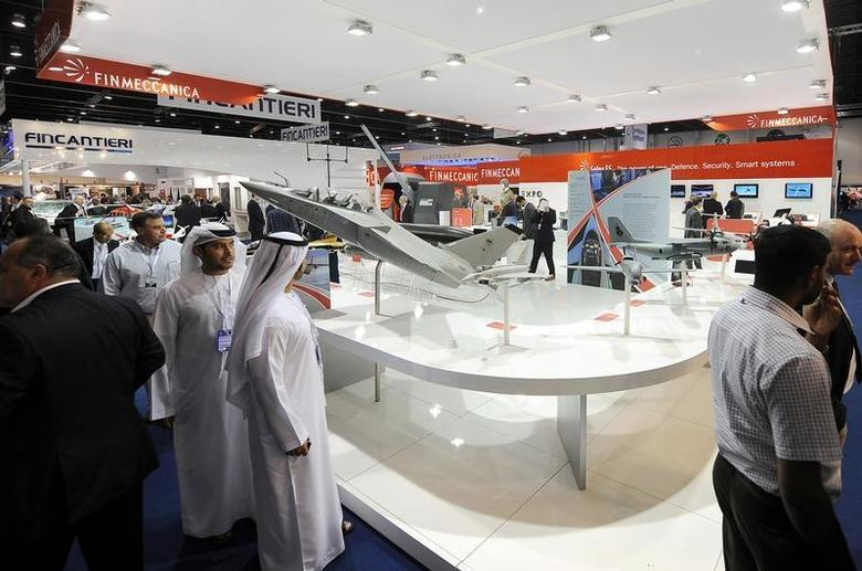 Visitors walk past a stand for Italian defence group Finmeccanica during the International Defence Exhibition and Conference (IDEX) at the Abu Dhabi National Exhibition Centre February 19, 2013. REUTERS/Ben Job