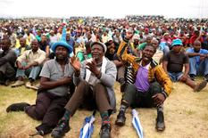 Miners gather at Wonderkop stadium outside the Lonmin mine in Rustenburg, northwest of Johannesburg January 30, 2014. REUTERS/Siphiwe Sibeko