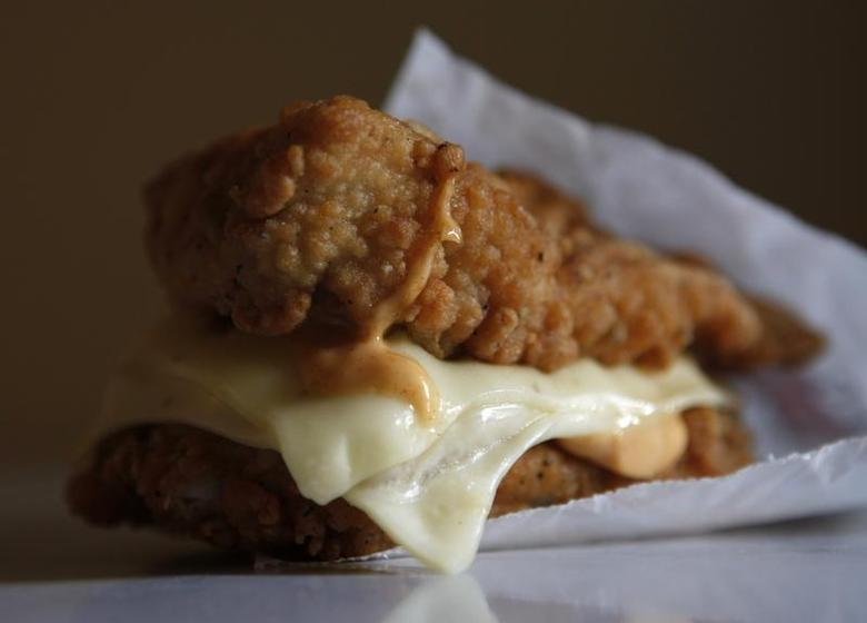 A KFC ''Double Down'' sandwich, consisting of bacon, cheese and a special sauce in between two slabs of fried chicken, is seen in Montreal October 19, 2010. REUTERS/Shaun Best