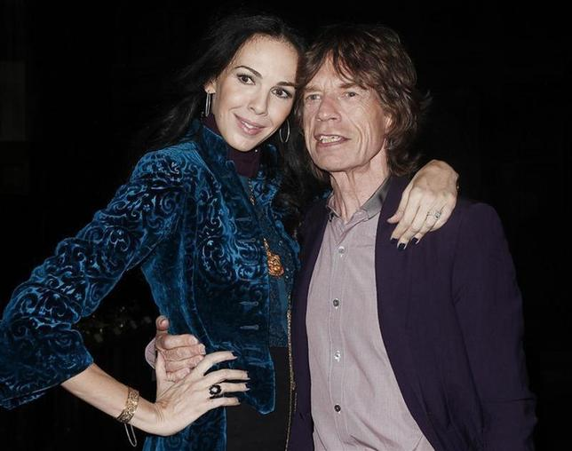 Musician Mick Jagger and designer L'Wren Scott pose following her Fall/Winter 2012 collection during New York Fashion Week, February 16, 2012. REUTERS/Carlo Allegri
