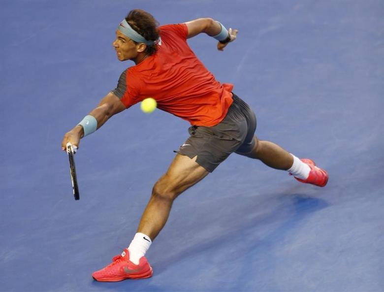 Rafael Nadal of Spain hits a return to Stanislas Wawrinka of Switzerland during their men's singles final match at the Australian Open 2014 tennis tournament in Melbourne January 26, 2014. REUTERS/Brandon Malone