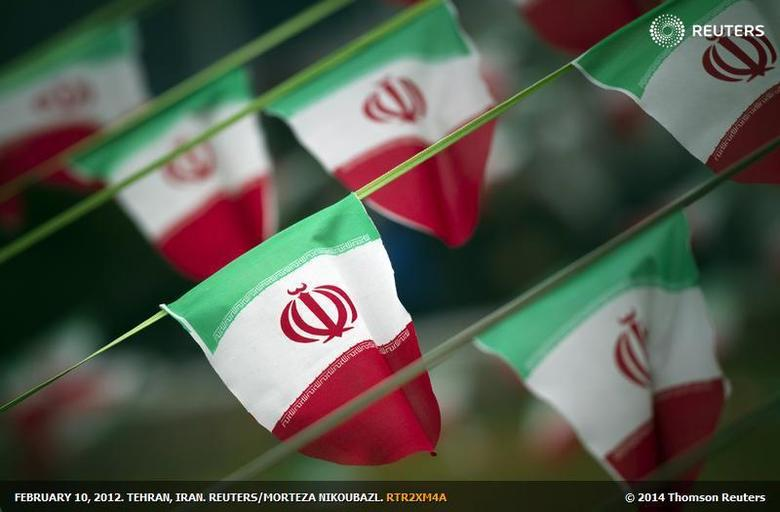 EDITORS' NOTE: Reuters and other foreign media are subject to Iranian restrictions on leaving the office to report, film or take pictures in Tehran. Iran's national flags are seen on a square in Tehran February 10, 2012, a day before the anniversary of the Islamic Revolution. REUTERS/Morteza Nikoubazl