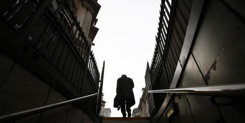 A worker walks up the steps from Bank station in London November 11, 2013. REUTERS/Eddie Keogh