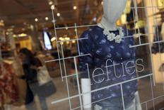 A woman shops at a Lefties store in Madrid March 14, 2014. REUTERS/Susana Vera