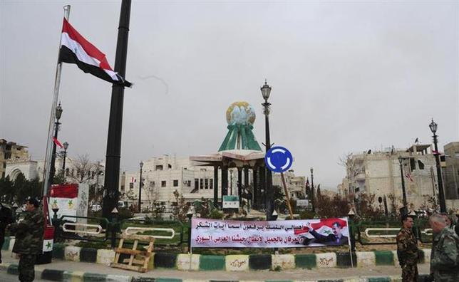 A banner of Syria's President Bashar al-Assad is seen at a Yabroud town square in the Damascus countryside, after the soldiers loyal to Assad took control of it from the rebel fighters, in this handout released by Syria's national news agency SANA on March 17, 2014. REUTERS/SANA/Handout via Reuters (