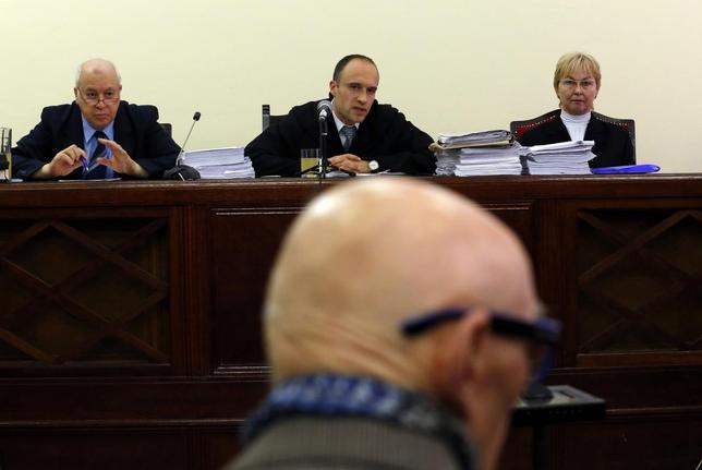 Former Communist Party leader Bela Biszku listens to judge Szabolcs Toth (top C) during his trial in Budapest March 18, 2014. REUTERS/Laszlo Balogh