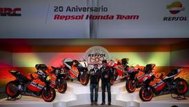 Spain's Marc Marquez (R), MotoGP 2013 World Champion, and his teammate compatriot Dani Pedrosa gesture during a ceremony to mark the 20th anniversary of the Repsol Honda motorcycling team in Madrid February 10, 2014. REUTERS/Sergio Perez