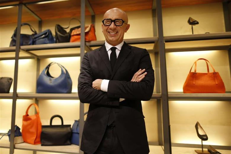 Marco Bizzari, President and Chief Executive Officer of Bottega Veneta, poses during an interview with Reuters at the Bottega Veneta's shop in Paris March 17, 2014. REUTERS/Charles Platiau