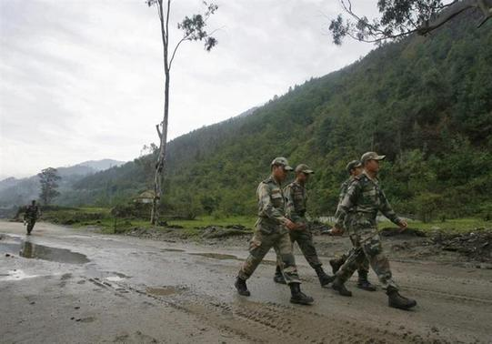 Indian army soldiers march near an army base on Tezpur-Tawang highway, which runs to the Chinese border, in Arunachal Pradesh May 29, 2012. REUTERS/Frank Jack Daniel/Files