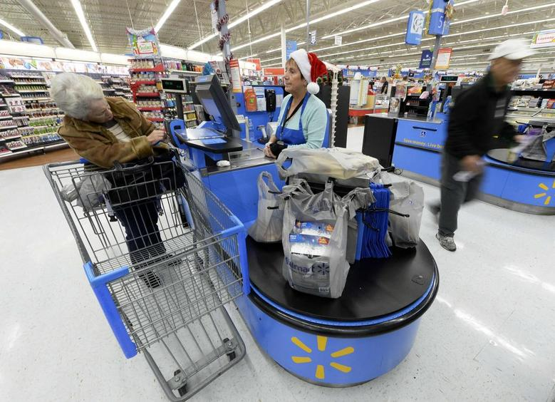 Customers shop at the Wal-Mart Supercenter in the Porter Ranch section of Los Angeles November 26, 2013. REUTERS/Kevork Djansezian