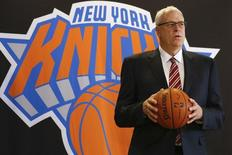 Phil Jackson poses during a news conference announcing him as the team president of the New York Knicks basketball team at Madison Square Gardens in New York March 18, 2014.REUTERS/Shannon Stapleton