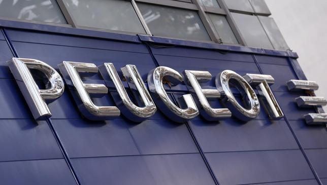 Exterior view of a Peugeot automobile dealer is seen in Paris December 13, 2013. REUTERS/Jacky Naegelen