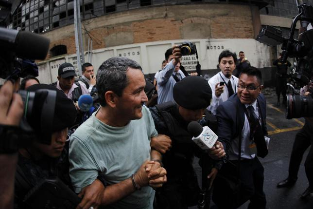 Waldemar Lorenzana is escorted by the Guatemalan police after his arrest outside the Supreme Court of Justice in Guatemala City, September 17, 2013. REUTERS/Jorge Dan Lopez