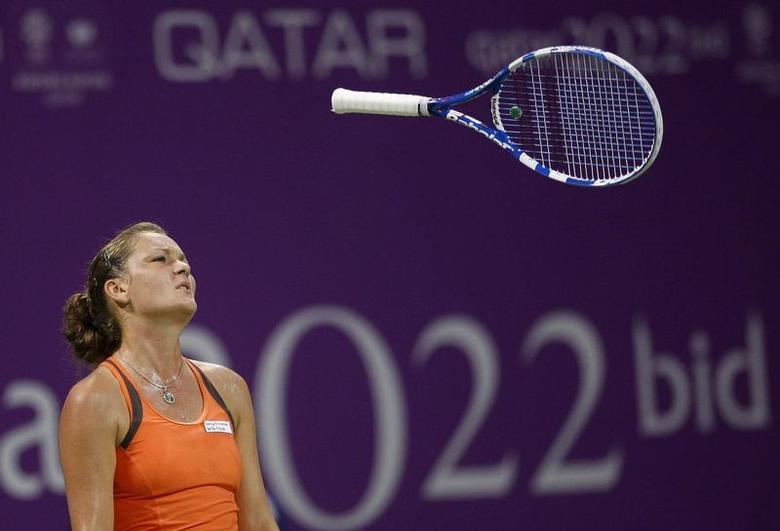 Agnieszka Radwanska of Poland throws her racket during her WTA Tour Championships tennis match against Victoria Azarenka of Belarus in Doha October 30, 2009. REUTERS/Fadi Al-Assaad