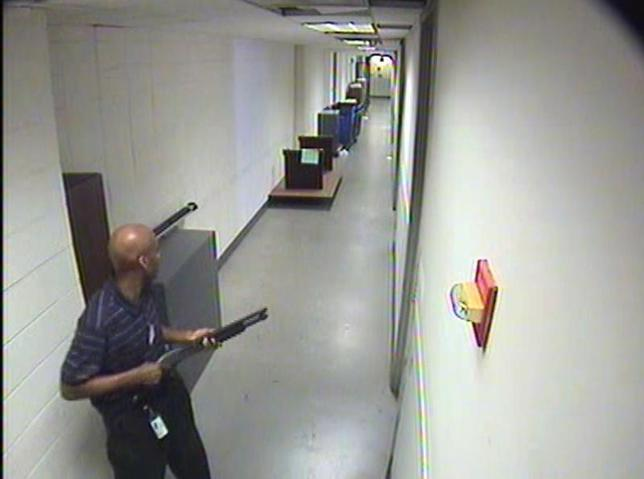 Aaron Alexis moves through the hallways of Building #197 carrying a Remington 870 shotgun in this undated handout photo released by the FBI. REUTERS/FBI/Handout via Reuters