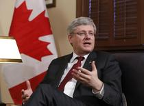 Canada's Prime Minister Stephen Harper speaks during a meeting with Ukraine?s Ambassador to Canada Vadym Prystaiko (not pictured) in Harper's Langevin Block office in Ottawa March 17, 2014. REUTERS/Chris Wattie