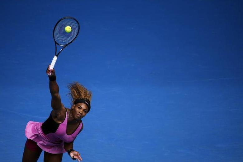 Serena Williams of the U.S. serves to Ana Ivanovic of Serbia during their women's singles match at the Australian Open 2014 tennis tournament in Melbourne January 19, 2014. REUTERS/Jason Reed