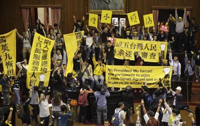 Taiwan students occupy legislature over China trade...